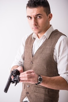 Portrait of a man is holding a gun