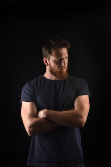 Portrait of a man look to the side and with arms crossed