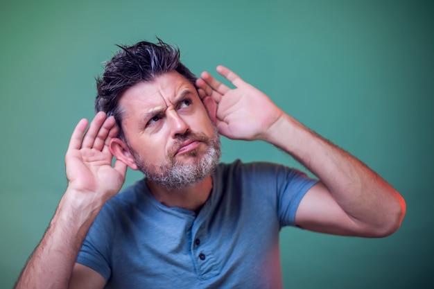 Portrait of man overhearing