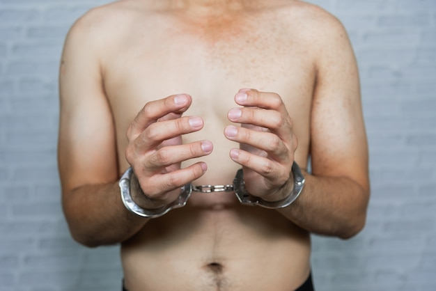 Portrait of a man prisoner with handcuff
