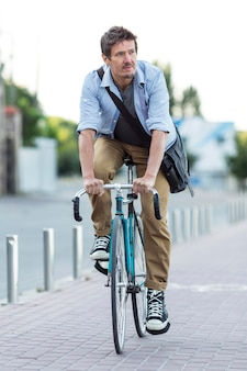 Portrait of man riding bicycle in the city