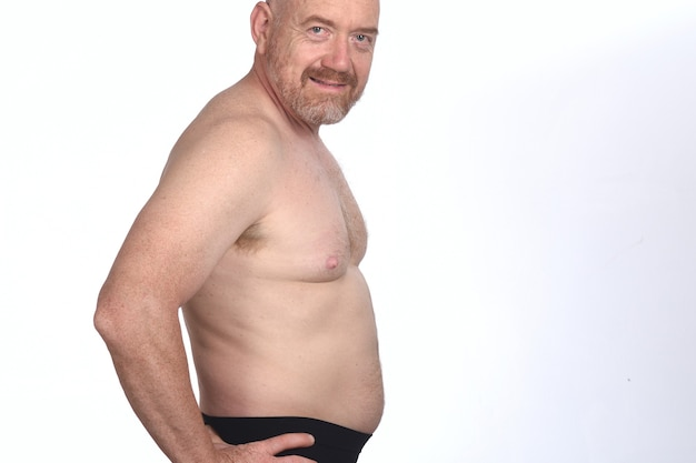 Portrait of a man shirtless on white background, side view