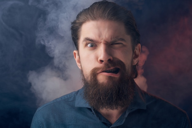 Portrait of a man smoke nicotine fashion lifestyle isolated background. high quality photo