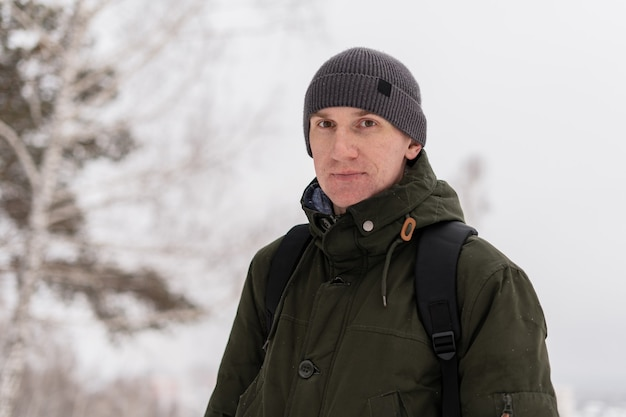 Portrait of a man in a snowy spot with snow remains on his face