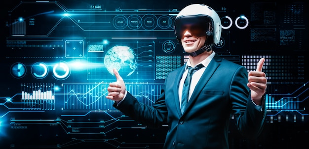 Portrait of a man in a suit and helmet. he is showing thumbs up against the background of a hologram of market trading. business concept. stock market. brokers and traders.