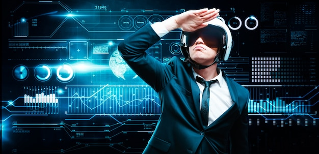Portrait of a man in a suit and helmet. he looks to the future against the background of a hologram of market trading. business concept. stock market. brokers and traders.