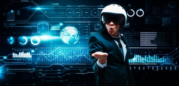 Portrait of a man in a suit and helmet. he put his palm against the backdrop of a hologram of market trading. business concept. stock market. brokers and traders.