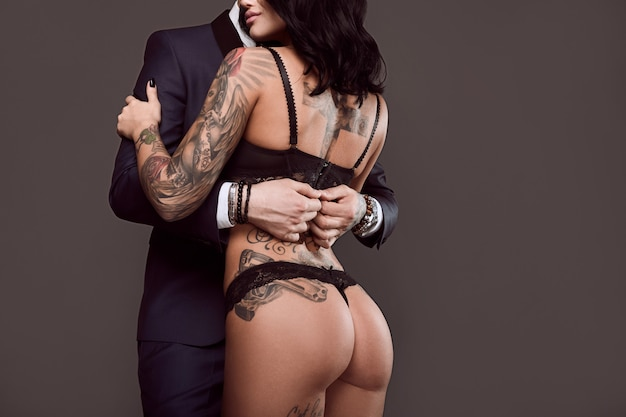 Portrait of a man in suit and sexy girl