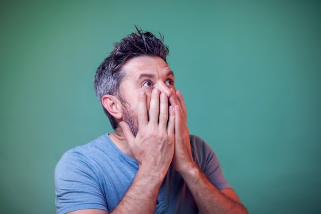 Portrait of man surprised about something