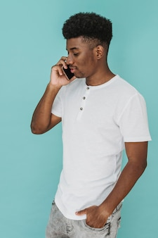 Portrait of man in t-shirt talking on smartphone