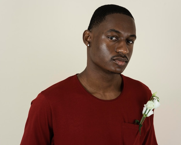 Portrait of man in a t-shirt with flowers in his chest pocket