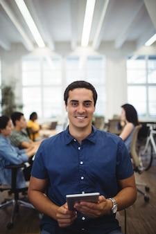 Portrait of man using digital tablet