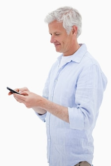 Portrait of a man using his mobile phone