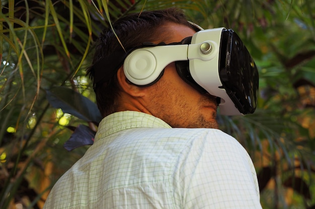 Portrait of a man in vr 360, virtual reality 3d headset and exploring the game