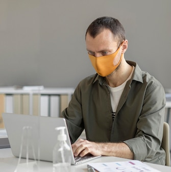 Portrait of man wearing face mask at work
