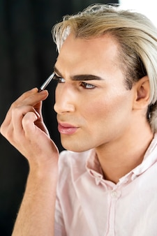 Portrait of man wearing make-up