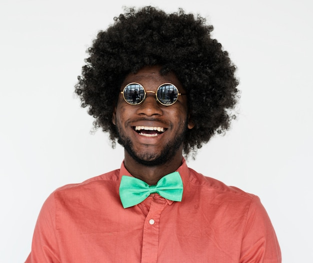 Portrait of a man with an afro wig and glasses