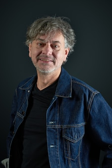 Portrait of a man with in blue denim jacket
