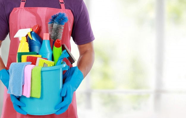 Portrait of man with cleaning equipment