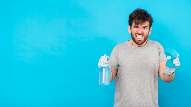 Portrait of man with cleaning product