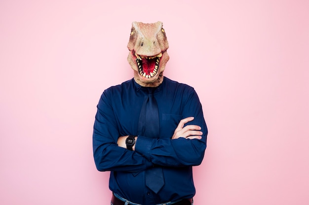 Portrait of man with dinosaur head and tie
