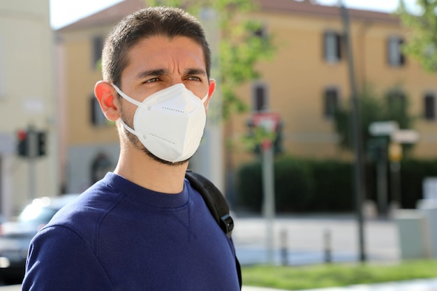Portrait of man with face mask against sars-cov-2.