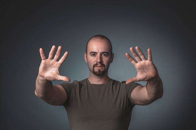 Portrait of a man with hands outstretched ahead of him