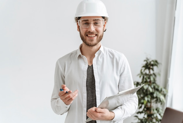 Portrait man with helmet at office