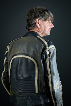 Portrait of a man with leather biker jacket