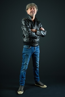 Portrait of a man with leather jacket and denim pant