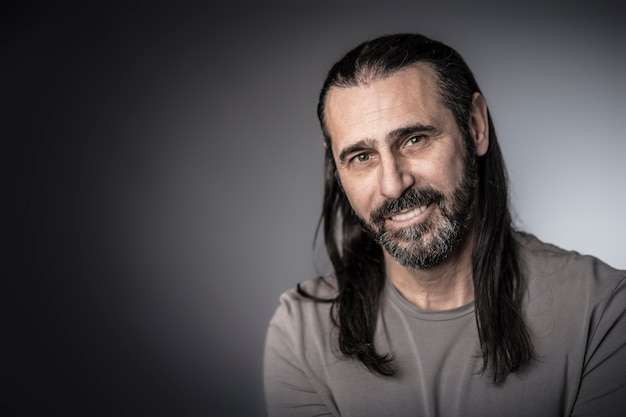 Portrait of man with long hair