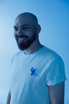 Portrait of man with prostate cancer ribbon