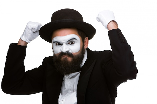 Portrait of a man with raised fists in makeup mime