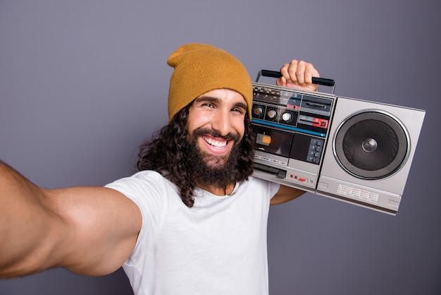 Portrait man with retro vintage player