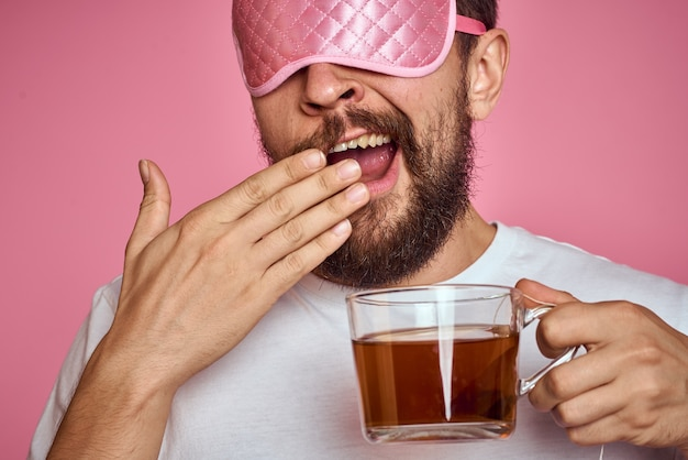 Portrait man with sleeping mask and tea