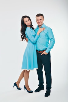 Portrait of a man and a woman. couple in blue clothes