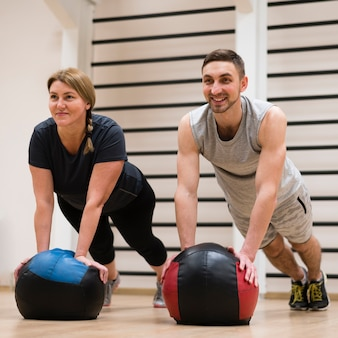 Portrait of man and woman working out