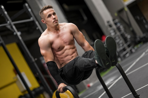 Portrait man working out at gym