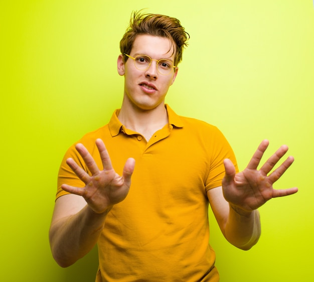 Portrait of a man on yellow background