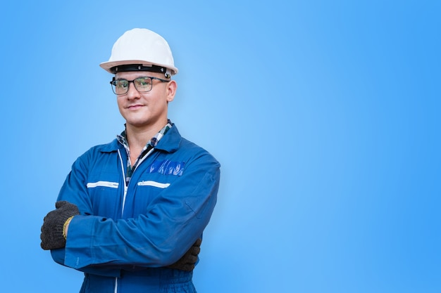 Portrait of manual man worker is standing with confident in front blue background