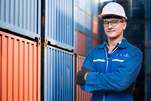 Portrait of manual man worker is standing with confident with blue working suite dress