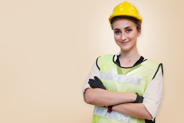 Portrait of manual woman worker is standing with confident