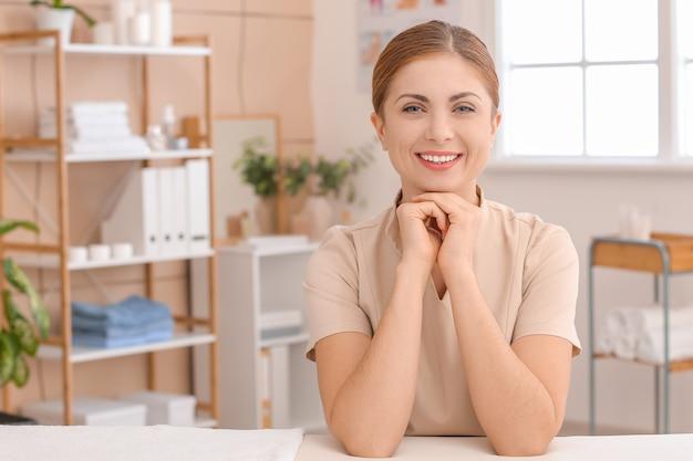 Portrait of massage therapist in medical center