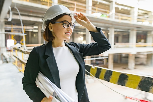 Portrait of mature architect woman at a construction site