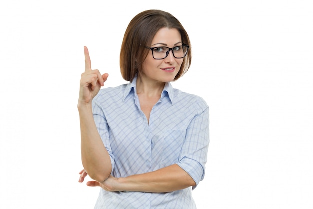 Portrait of mature businesswoman showing index finger up