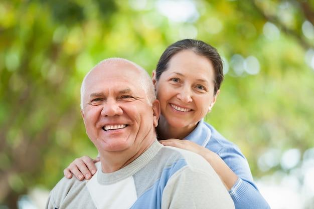 Portrait of mature couple at autumn park