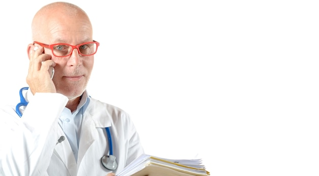 Portrait of mature doctor with phone isolated