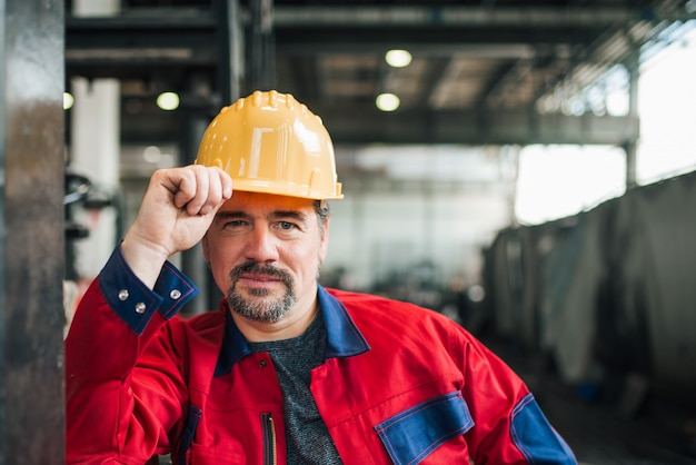 Portrait of a mature heavy industry worker at factory, head shot.
