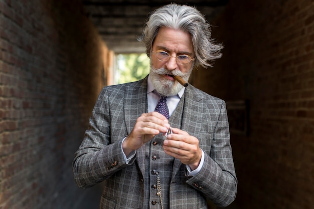 Portrait of mature male lightning cigar