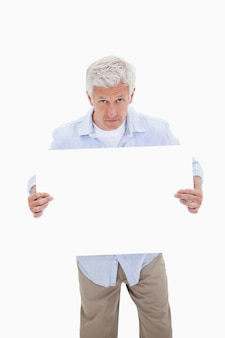 Portrait of a mature man holding a blank board
